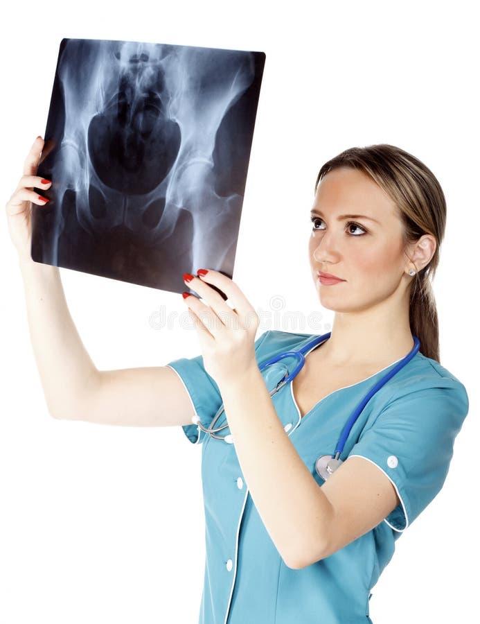 проверять рентгеновский снимок изображения доктора женский стоковые изображения