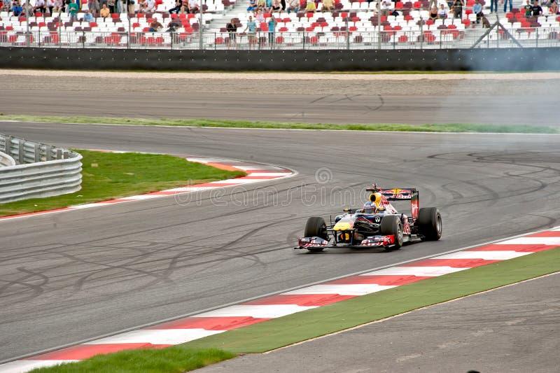 Проведение демонстрации гоночной машины Формула-1 стоковое фото rf
