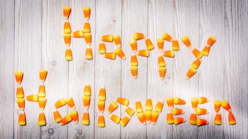 Произношения по буквам счастливый хеллоуин мозоли конфеты стоковые изображения rf