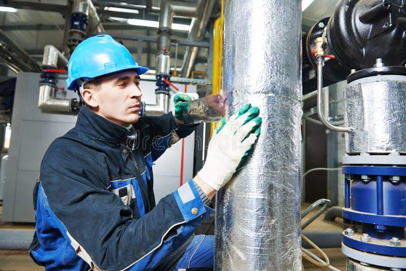 Промышленный работник на работе изоляции стоковая фотография