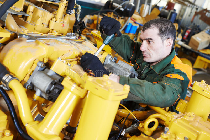 Промышленный работник сборщика стоковое фото