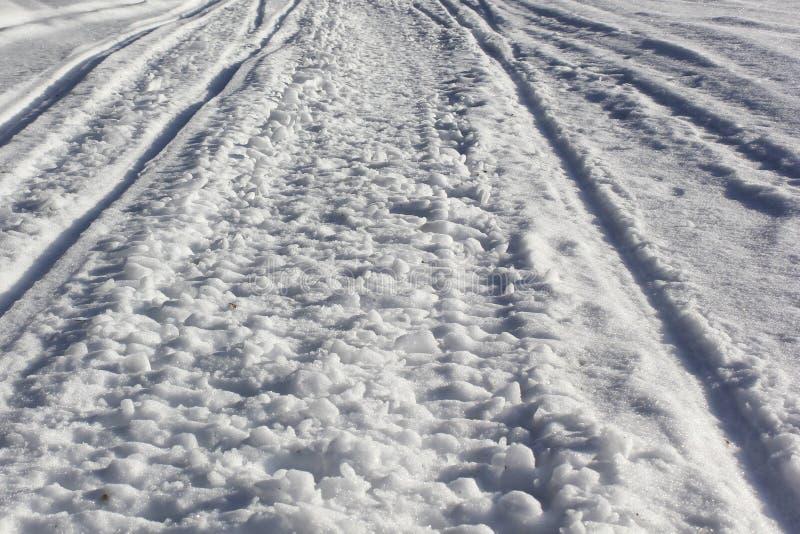 Проселочные дороги текстуры снежные стоковая фотография rf