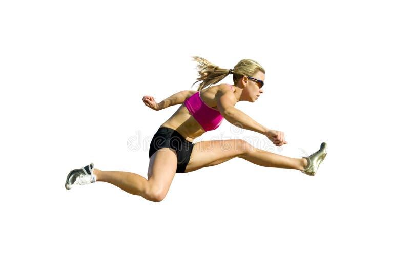 против белизны предпосылки спортсмена скача стоковое изображение