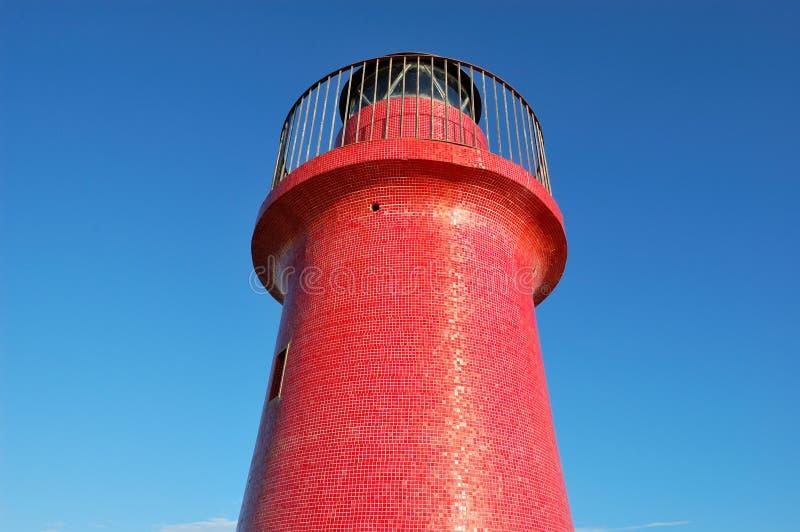 против красного цвета маяка стоковое изображение rf