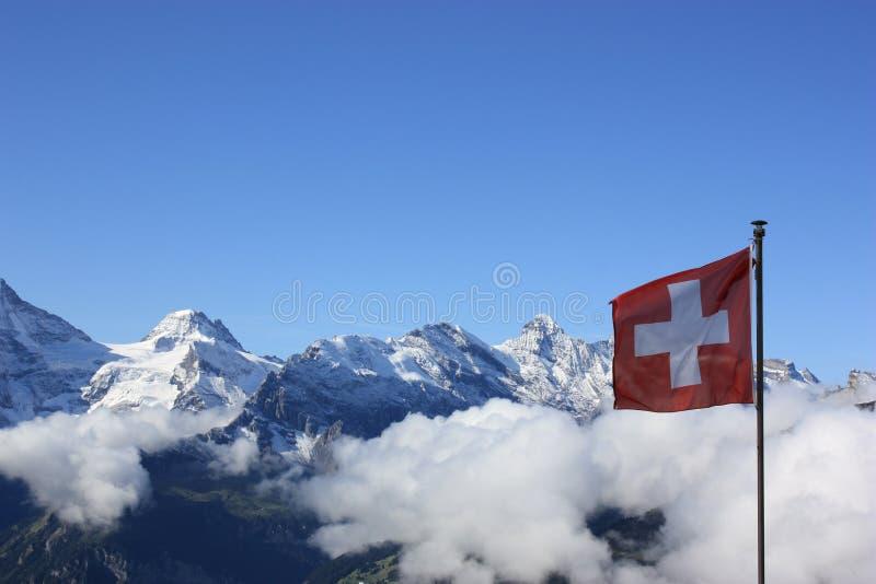 против alps flag швейцарская Швейцария стоковое фото rf