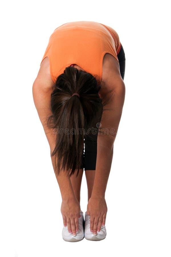 протягивать йогу касания пальца ноги стоковые фото