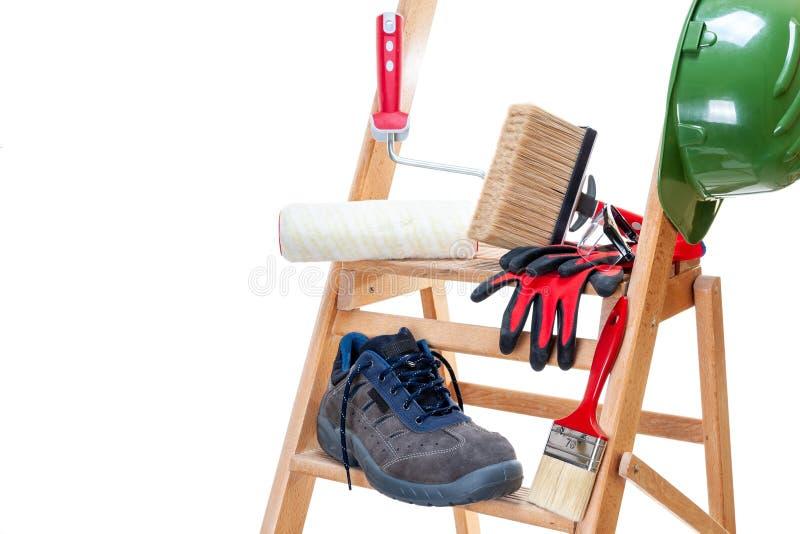 Профессиональные маляр, инструменты и оборудование работы стоковое фото