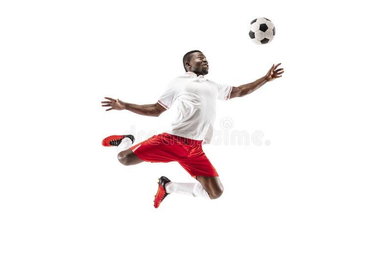 Профессиональный африканский футболист футбола изолированный на белой предпосылке стоковая фотография rf