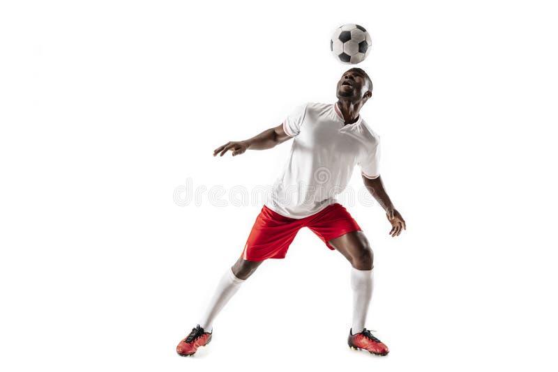 Профессиональный африканский футболист футбола изолированный на белой предпосылке стоковое фото rf