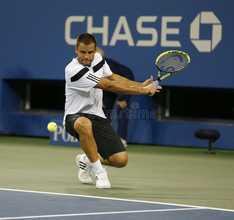 Профессиональный теннисист Mikhail Youzhny во время спички четвертьфинала на США раскрывает 2013 против Novak Djokovic стоковое изображение