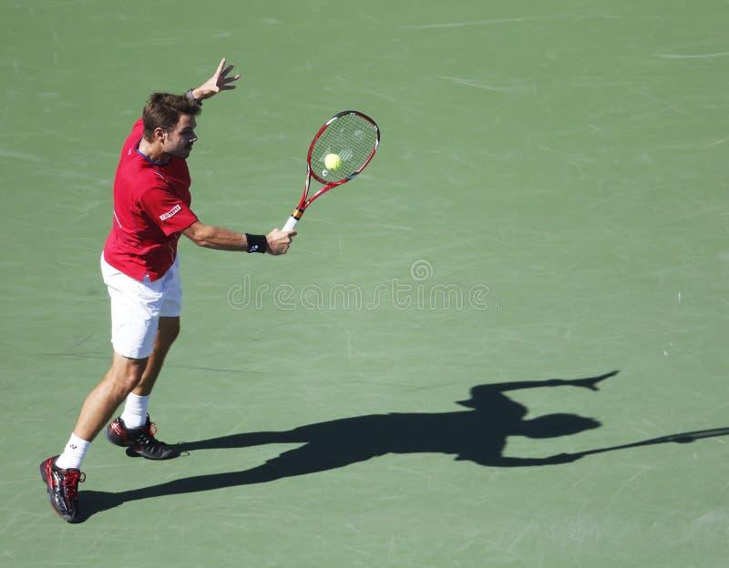 Профессиональный теннисист Stanislas Wawrinka во время спички четвертьфинала на США раскрывает 2013 против Andy Мюррея стоковые фото
