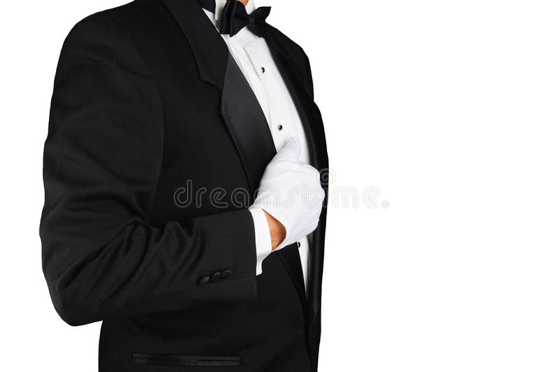 Профиль крупного плана человека нося смокинг и белые перчатки держа его отворот стоковое изображение rf
