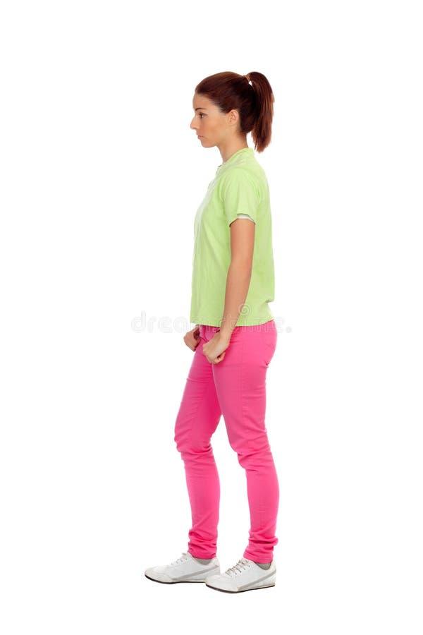 Профиль вскользь девушки с розовыми джинсами стоковое фото rf