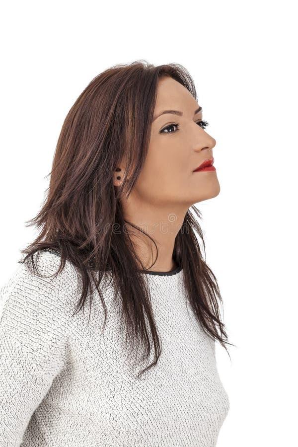 Профиль молодой женщины стоковое изображение