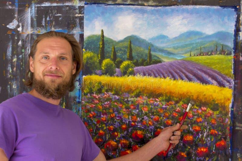 Процесс искусства творческий Художник создает крася итальянскую сельскую местность лета Тоскана Поле красных маков, поле желтой р стоковые изображения