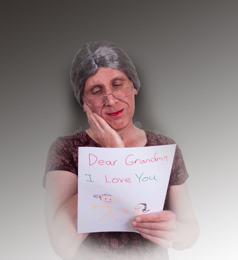 прочитанная влюбленность письма бабушки crayon ребенка счастливая стоковое изображение rf