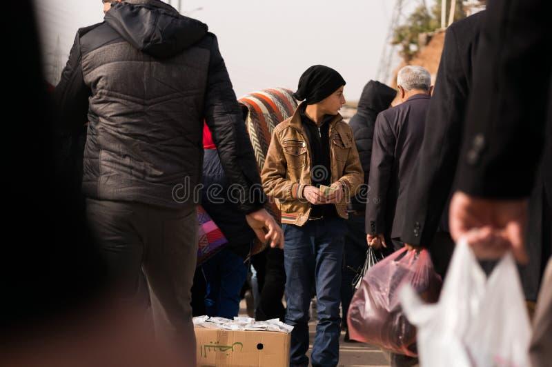 Продавец ребенка в Ираке стоковое фото