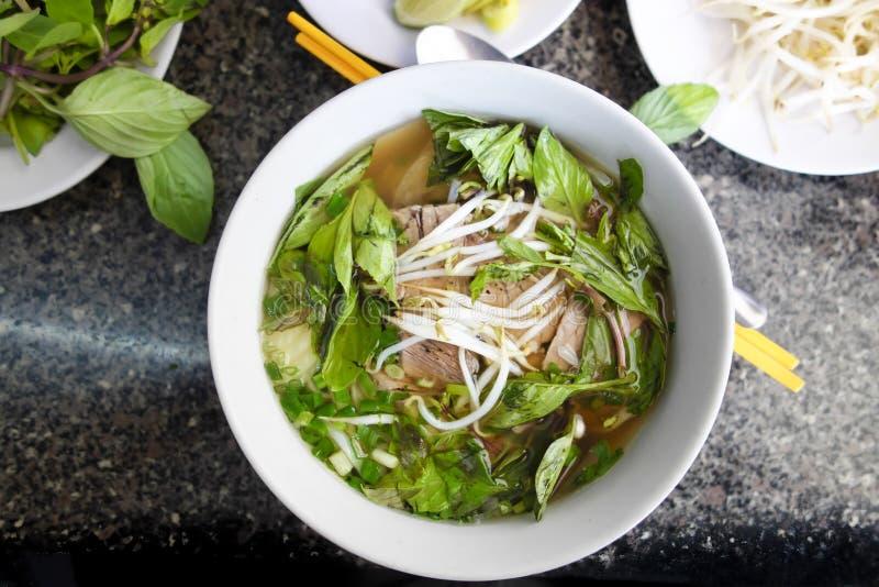 Пряный азиатский суп лапши говядины стоковые фото