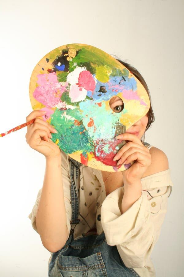 пряча краска стоковое изображение