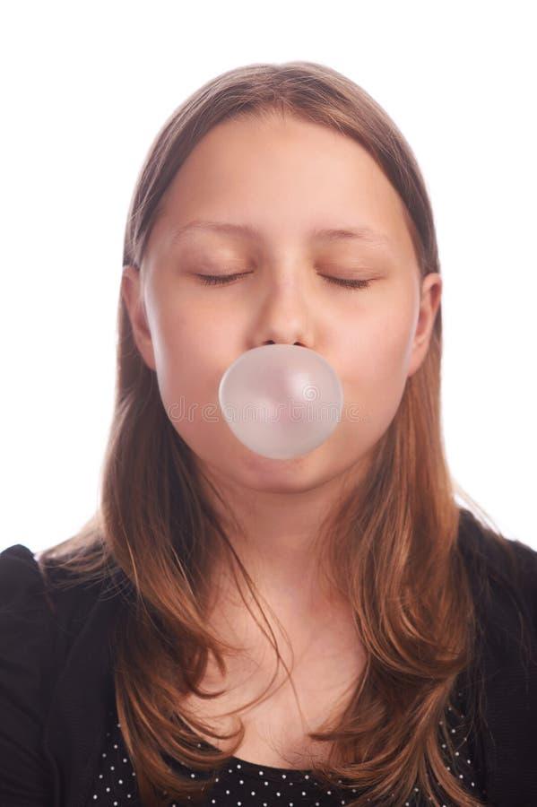 Пузыри предназначенной для подростков девушки дуя на белой предпосылке стоковая фотография rf