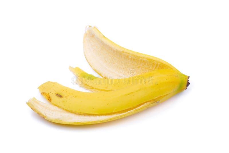 Пук бананов и банан слезают изолированный на белой предпосылке стоковое изображение