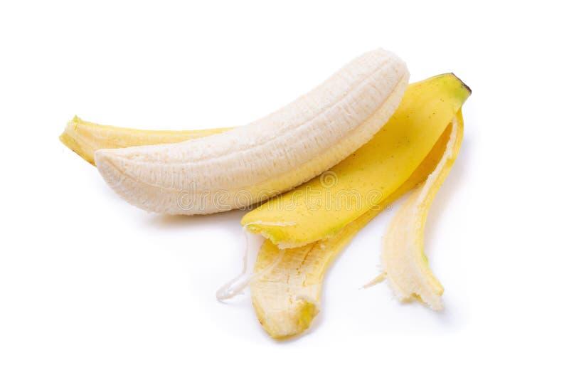 Пук бананов и банан слезают изолированный на белой предпосылке стоковая фотография rf