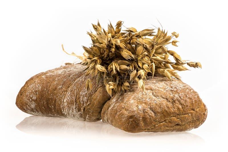 Пук овса и испеченный хлеб стоковое фото
