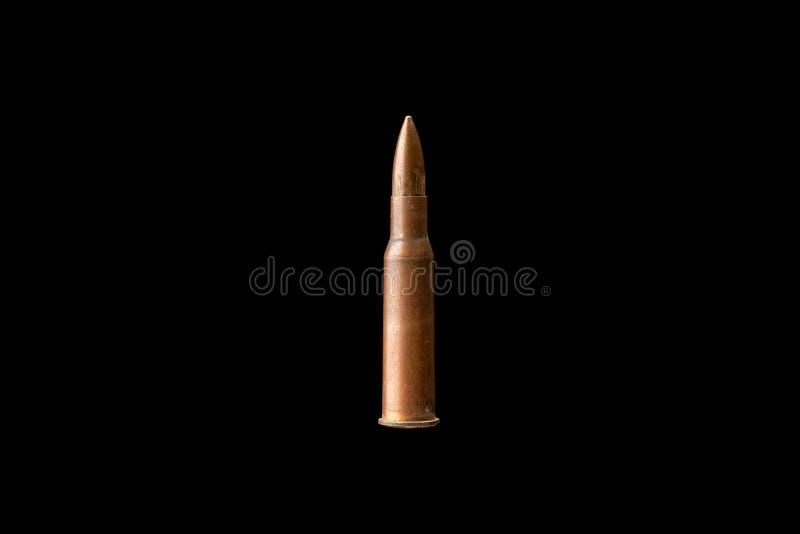 Пуля винтовки изолированная на черной предпосылке стоковое фото rf