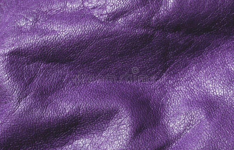 Пурпуровая кожаная текстура стоковые изображения