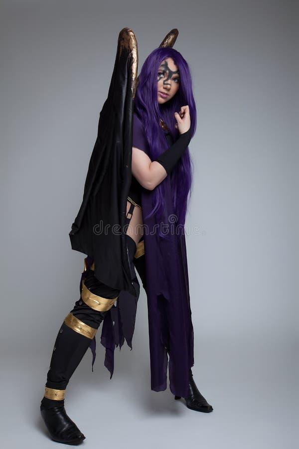 пурпур девушки неистовства costume характера cosplay стоковое изображение rf