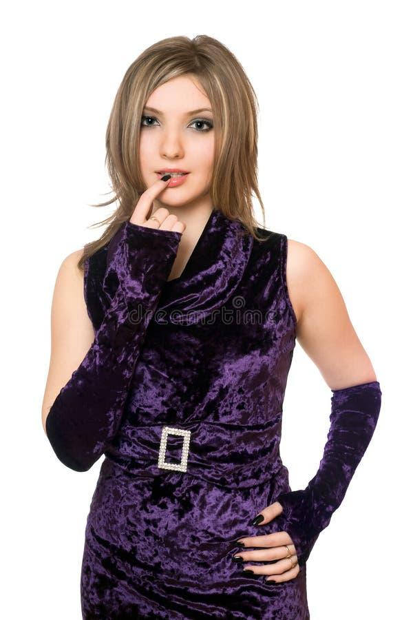 пурпур девушки платья симпатичный шаловливый стоковое изображение