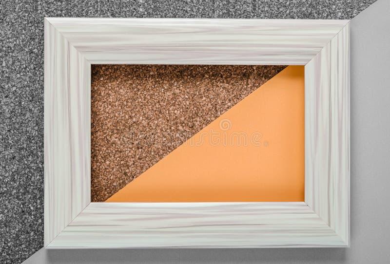 Пустая белая винтажная рамка на оранжевом цвете стоковые фотографии rf