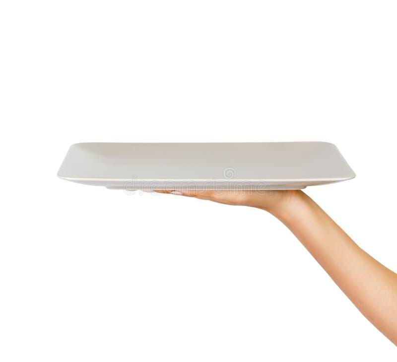 Пустая белая штейновая прямоугольная плита в женской руке взгляд перспективы, изолированный на белой предпосылке стоковое фото rf