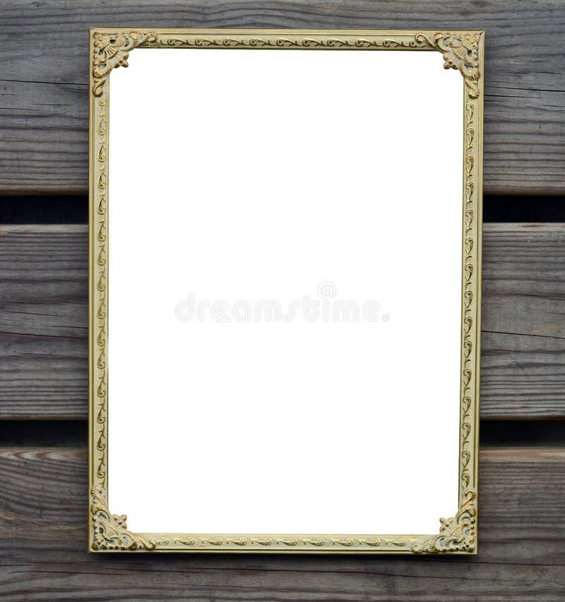 Пустая золотая картинная рамка на деревянной стене стоковые изображения