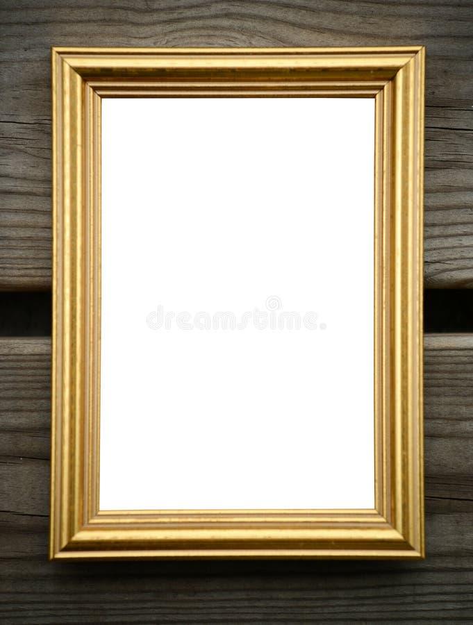 Пустая золотая картинная рамка на деревянной стене стоковое изображение rf
