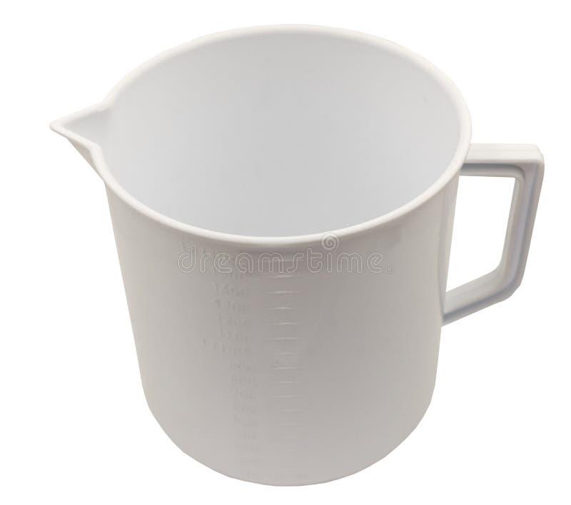 Пустая измеряя чашка изолированная на белизне стоковые фото