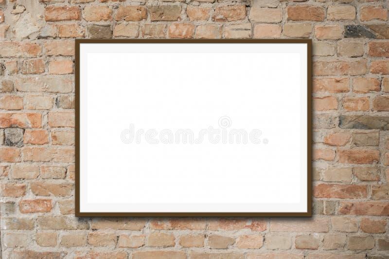 Пустая картинная рамка/белый модель-макет холста на кирпичной стене стоковое изображение rf