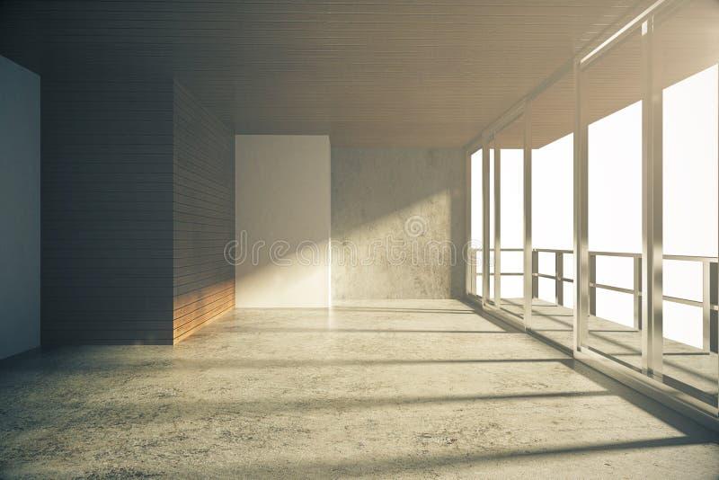 Пустая комната стиля просторной квартиры с конкретным полом на восходе солнца стоковое фото