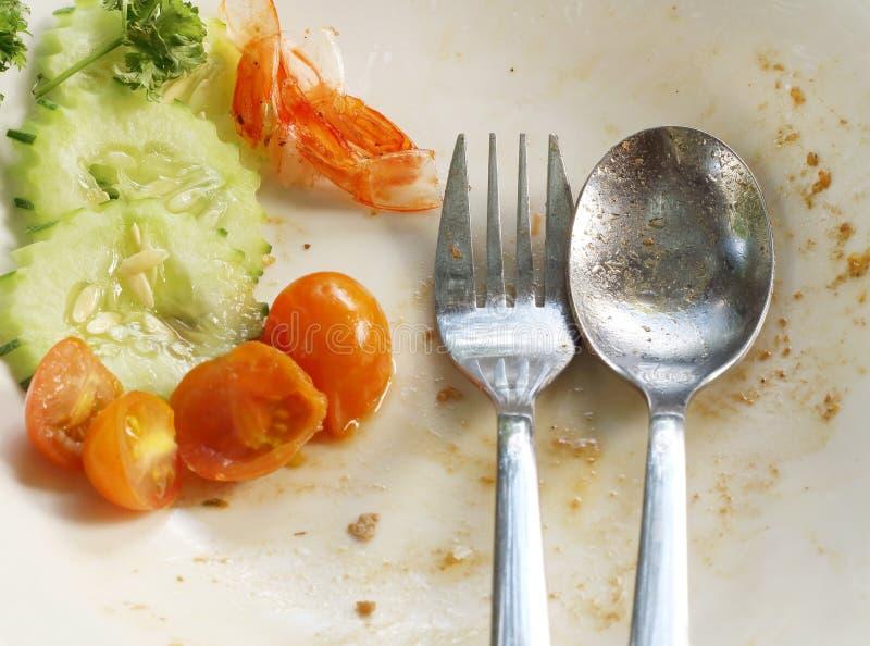 Пустая плита вышла после еды, остаток еды стоковые изображения