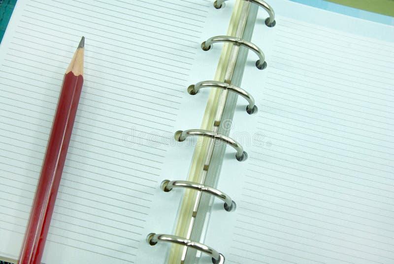 Пустая тетрадь с карандашем стоковая фотография