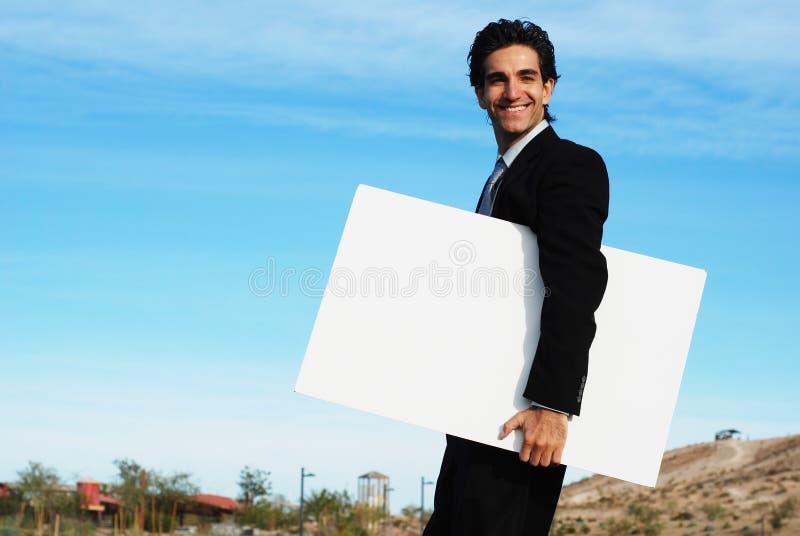 пустое удерживание бизнесмена доски стоковая фотография