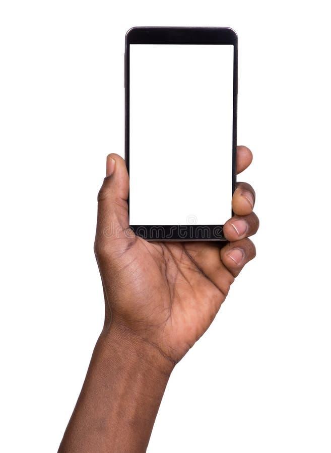 пустое удерживание руки изолировало белизну экрана мобильного телефона франтовскую стоковое фото