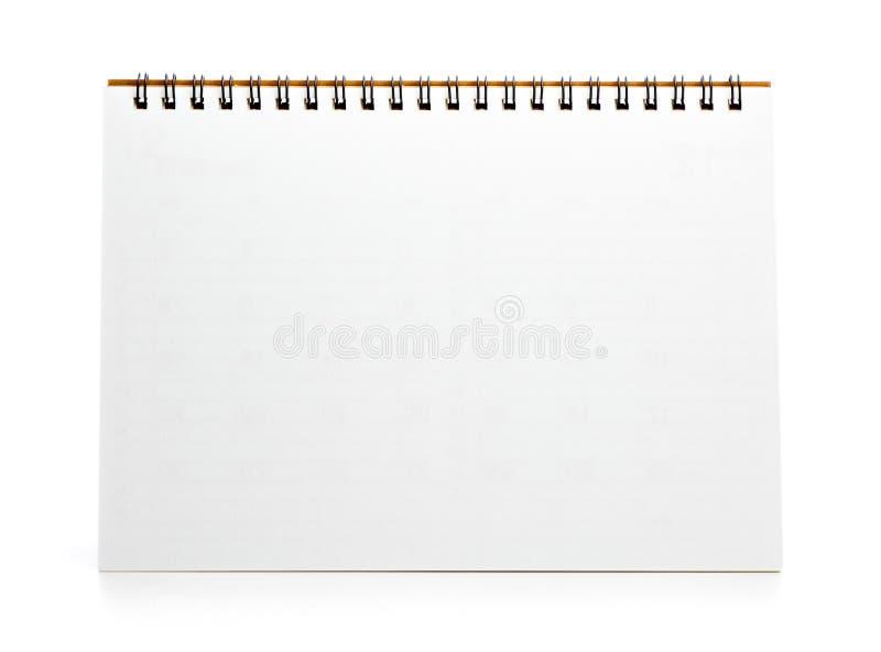 Пустой настольный календарь изолированный на белизне стоковые фото