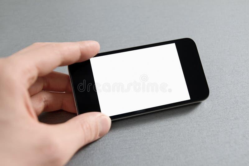 пустой показ мобильного телефона руки стоковое фото