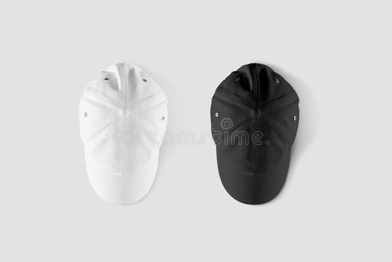 Пустой черно-белый комплект модель-макета бейсбольной кепки, верхний взгляд со стороны стоковая фотография rf