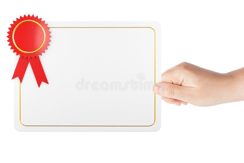 Пустой шаблон диплома сертификата в руке стоковое фото rf