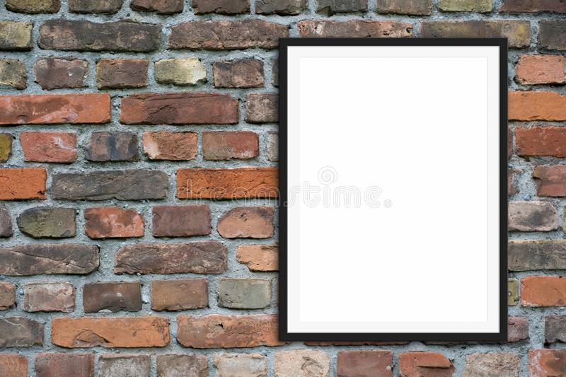 Пустые модель-макет картинной рамки и космос экземпляра на предпосылке каменной стены кирпича стоковые фото