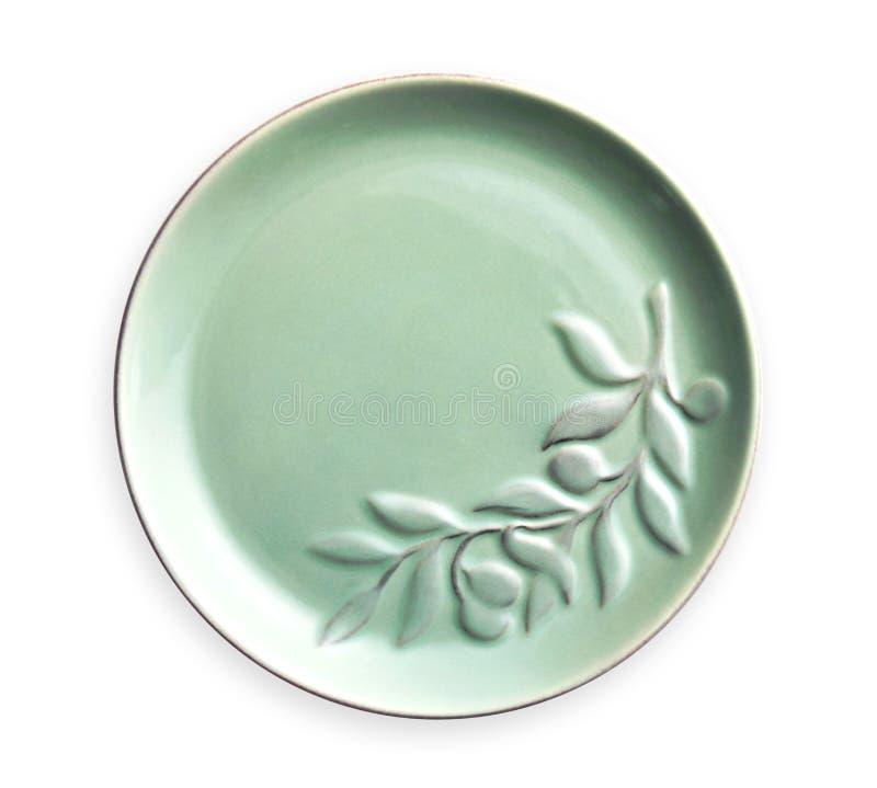 Пустые плиты керамики, зеленая плита с цветочным узором, осматривают сверху изолированный на белой предпосылке с путем клиппирова стоковое изображение rf