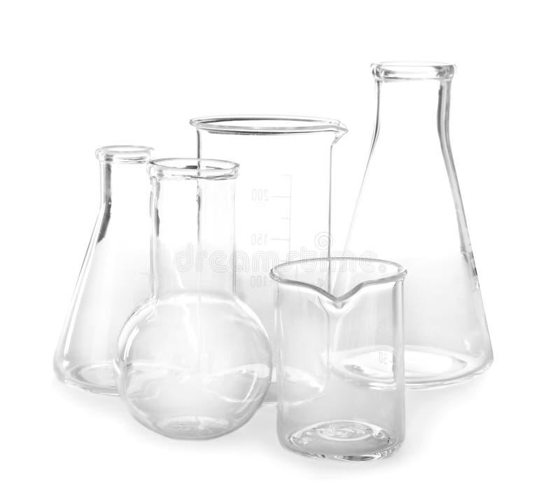 Пустые склянки на белой предпосылке стоковые изображения