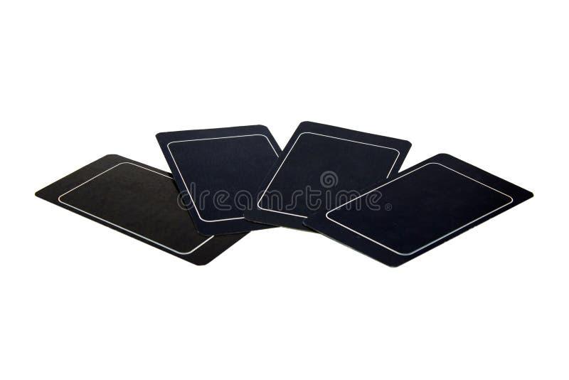 4 пустых черных карточки на таблице стоковые изображения